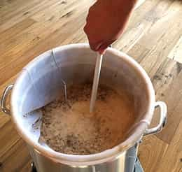 stirring grains in a brew in a bag