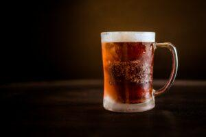 Perfectly Carbonated amber home brewed Beer in mug