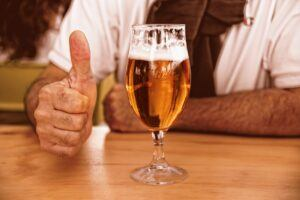 Man giving a thumbs up to his home brew