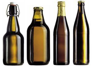 4 different styles of home brew bottles