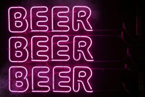 Neon sign with beer written 3 times